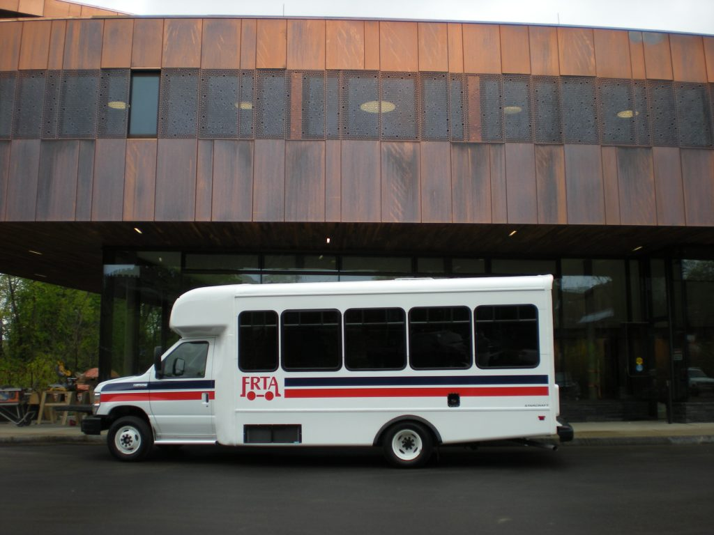 small FRTA bus in front of transit station in Greenfield