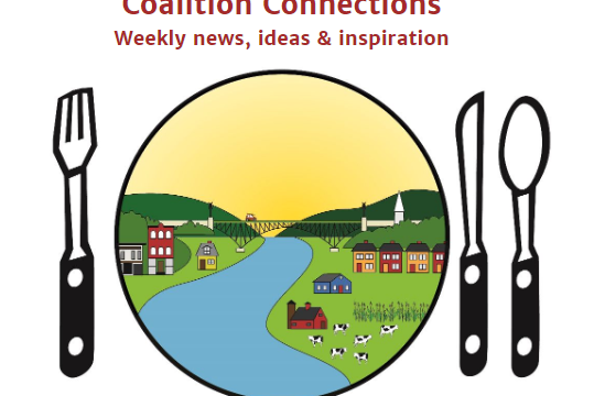 A colorful circular illustration of a river with buildings on each of its banks and a bridge connecting the two sides. Drawings of a fork, knife, and spoon on either side of the circle make it resemble a place setting.