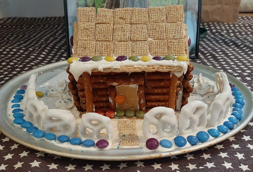 Home made pretzel stick log house, similar to a gingerbread house.